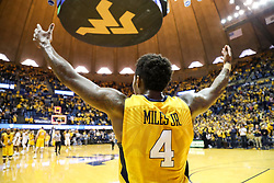 Jan 20, 2018; Morgantown, WV, USA; West Virginia Mountaineers guard Daxter Miles Jr. (4) celebrates after beating the Texas Longhorns at WVU Coliseum. Mandatory Credit: Ben Queen-USA TODAY Sports