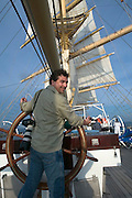 The Royal Clipper setting sails. Heimo Aga at the steering wheel.