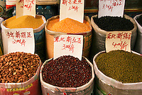 Various grains, nuts and beans at a Chengdu Market, displayed with prices per kilo in burlap and plastic bags. Grains are an important element in Chinese cuisine, though it is often said that people will eat anything with legs except for a table.