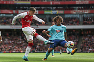 Mesut Ozil of Arsenal shoots at goal under pressure from Nathan Ake of AFC Bournemouth . Premier league match, Arsenal v AFC Bournemouth at the Emirates Stadium in London on Saturday 9th September 2017. pic by Kieran Clarke, Andrew Orchard sports photography.