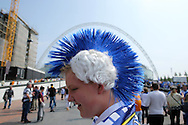 a young Sheffield Wednesday fan wearing a mohawk wig poses outside the arch of Wembley Stadium before k/o. Skybet football league Championship play off final match, Hull city v Sheffield Wednesday at Wembley Stadium in London on Saturday 28th May 2016.<br /> pic by John Patrick Fletcher, Andrew Orchard sports photography.