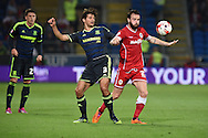 John Brayford of Cardiff city ® is challenged by George Friend of Middlesbrough .Skybet football league championship match, Cardiff city v Middlesbrough at the Cardiff city stadium in Cardiff, South Wales on Tuesday 16th Sept 2014<br /> pic by Andrew Orchard, Andrew Orchard sports photography.