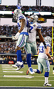 Dallas Cowboys wide receiver Dez Bryant (88) and fullback Lawrence Vickers (47) celebrate after a Bryant scored a touchdown against the Pittsburgh Steelers at Cowboys Stadium in Arlington, Texas, on December 16, 2012.  (Stan Olszewski/The Dallas Morning News)