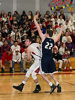 Trevor Hunt of Belmont looks for a shot around Andrew Geppert of St. Thomas Aquinas during NHIAA Division III second round tournament play on Thursday evening at Belmont High School.  (Karen Bobotas/for the Laconia Daily Sun)