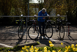 Race preparation amongst the Spring daffodils at Dwars door Vlaanderen 2017. A 114 km road race on March 22nd 2017, from Tielt to Waregem, Belgium. (Photo by Sean Robinson/Velofocus)