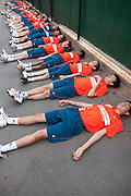 Roland Garros. Paris, France. June 1st 2012.A day with the ball boys..After warming up, ball boys relax for five minutes