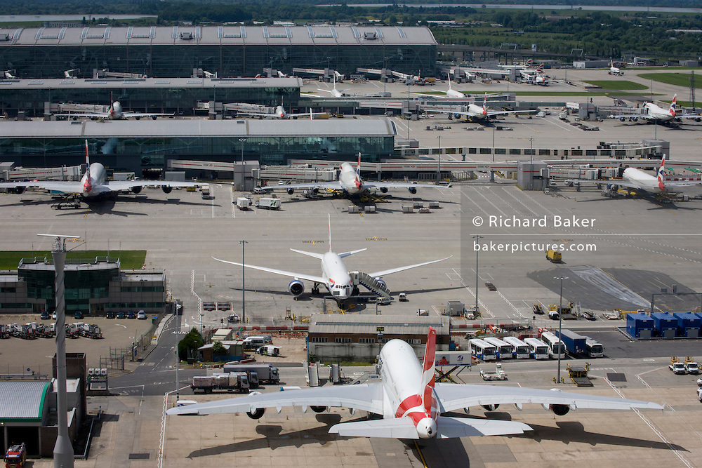 Aerial view (of Terminal 5, from control tower) showing expanse of airport land with airliners at London Heathrow.