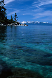 """""""Memorial Point, Lake Tahoe"""" - Photography of clear Lake Tahoe water at Memorial Point with snowy mountains in the background."""