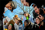 Participants huddle together to check on their finishing times at the annual Matawan 5K Turkey Trot held along downtown Matawan on November 27.  The annual event, hosted by the Matawan Borough Recreation Commission, was held to raise funds that will be directly put back into the Matawan Borough Parks.