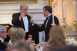 United States President Donald J. Trump shares a toast with French President Emmanuel Macron during the State Dinner for Macron and Mrs. Brigitte Macron of France during a visit to The White House in Washington, DC, April 24, 2018. Credit: Chris Kleponis / Pool via CNP