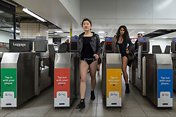 "© Licensed to London News Pictures. 13/01/2019. LONDON, UK.  Participants take part in ""No Trousers On The Tube Day"".  Now in its 10th year, the annual event sees hundreds of riders travel on the tube without wearing trousers.  Similar rides are taking place worldwide under the umbrella of ""No Pants Subway Ride"", which launched in New York in 2002.  Photo credit: Stephen Chung/LNP"