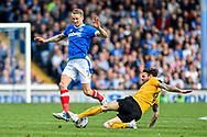 Cambridge United Midfielder, James Dunne (4) tackles Portsmouth Midfielder, Carl Baker (7) during the EFL Sky Bet League 2 match between Portsmouth and Cambridge United at Fratton Park, Portsmouth, England on 22 April 2017. Photo by Adam Rivers.