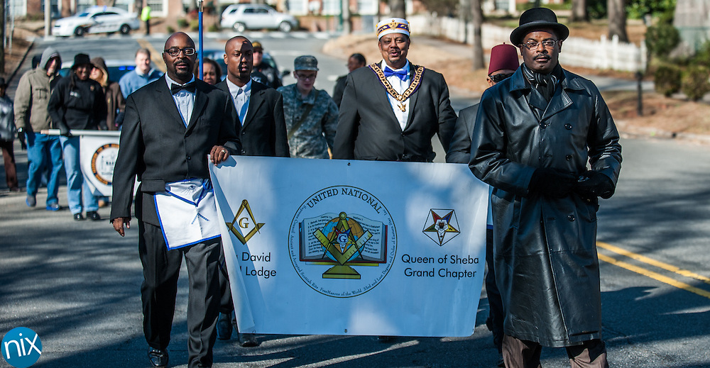 The Logan Community Association, along with various churches and organization, take part in a memorial march honoring Dr. Martin Luther King Jr. down Union Street in Concord Saturday afternoon.