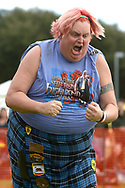"""Beth Burton, of Chico, Calif., after throwing a 28-pound weight over a height of 18'-1"""", for a new field record, in the Weight Over Bar competition during the Central Florida Scottish Highland Games in Winter Springs, Fla., Sunday, Jan. 19, 2014.(Special to the Sentinel/Phelan M. Ebenhack)"""