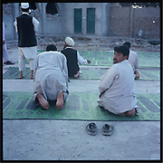 Men pray in a mosque in Kabul.