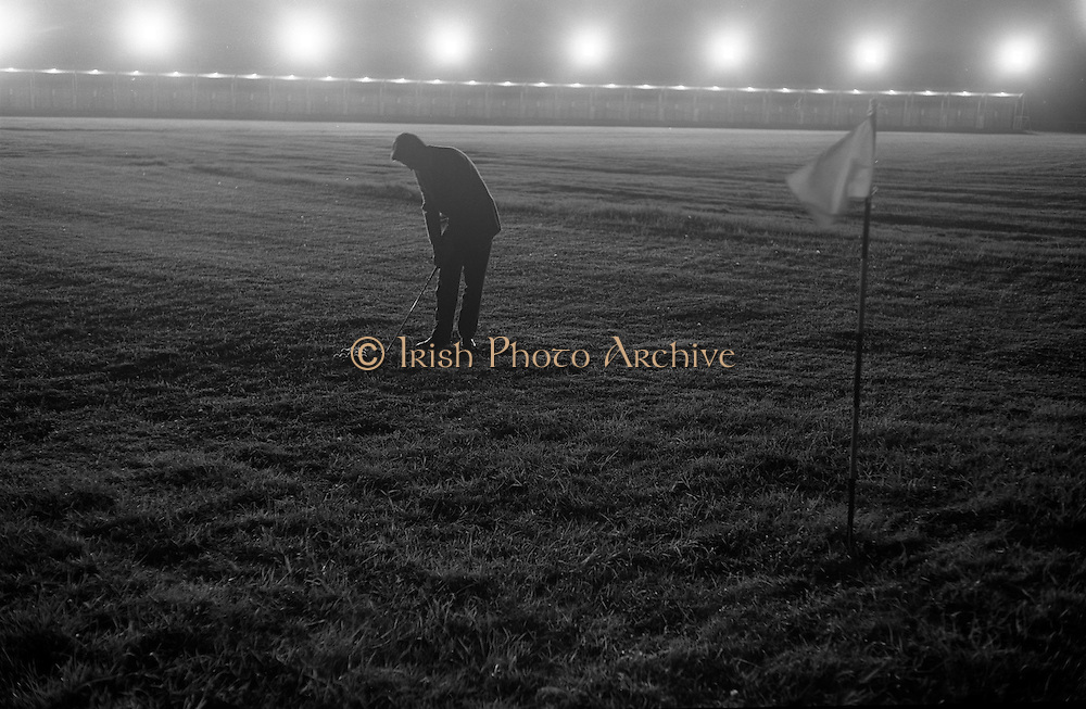 14/05/1965<br /> 05/14/1965<br /> 14 May 1965<br /> New Golf Range at Leopardstown, Foxrock, Dublin. Image shows Golfer on the range at night under lights.