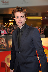 © under license to London News Pictures. LONDON. UK. 03/05/11. Stars of the new movie ' Water For Elephants' Robert Pattinson and Reese Witherspoon pose on the red carpet at the UK film premiere held in the Westfield centre in London. Photo credit should read Theo Wood/LNP