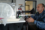 Photographer Solvin Zankl photographing mating fruit Flies (Drosophila melanogaster) in a lab culture