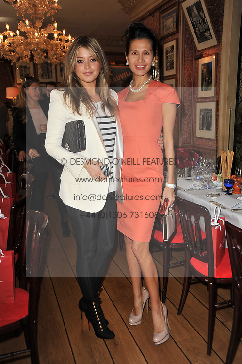 Left to right, HOLLY VALANCE and GOGA ASHKENAZI at a lunch hosted by Roger Viver in honour of Bruno Frisoni their creative director, held at Harry's Bar, 26 South Audley Street, London on 31st March 2011.