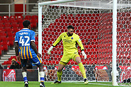 15 Steve Arnold for Shrewsbury Town watches the ball bounce off his leg and into his goal but it was disallowed for offside during the The FA Cup 3rd round replay match between Stoke City and Shrewsbury Town at the Bet365 Stadium, Stoke-on-Trent, England on 15 January 2019.