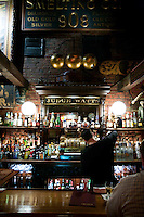 A bartender pours a drink at the upstairs bar of the Saloon in South Philadelphia on Sept. 26, 2007.