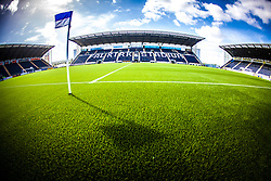 Picture from the half-way line showing the three stands and the new plastic pitch, at The Falkirk Stadium, for the Scottish Championship game v Hamilton. The woven GreenFields MX synthetic turf and the surface has been specifically designed for football with 50mm tufts compared with the longer 65mm which has been used for mixed football and rugby uses.  It is fully FFA two star compliant and conforms to rules laid out by the SPL and SFL.<br /> ©Michael Schofield.