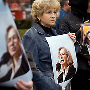 People arrive to pay tribute to Russian journalist Anna Politkovskaya, murdered in Moscow on 7 October, 2006...Known for her critical coverage of the war in.Chechnya, she was shot to death in the elevator of her apartment building in Moscow, in a killing prosecutors believe could be connected to her investigative work..Politkovskaya was a tireless reporter who had written a critical book on Russian President Vladimir Putin and his campaign in Chechnya, documenting widespread abuse of civilians by government troops..Prosecutors have opend a murder investigation into her death, said Svetlana Petrenko, spokeswoman for the Moscow prosecutor's Office. Investigators suspect the killing was connected to the work of the 48-year-old journalist, Vyacheslav Raskinsky, Moscow's first deputy prosecutor said on state-run Rossiya television.