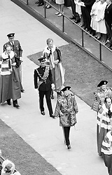 Prince Charles, uniformed as Colonel-in-Chief, Royal Regiment of Wales, shown in procession inside Caernarfon Castle. In front is Walter Verco, Chester Herald of Arms.