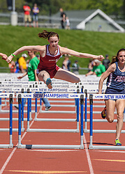 Hanover senior Abigail Feyrer clears the final hurdle in the girls 100 meter hurdles at the NHIAA Division II track and field championship at UNH on Saturday, May 25, 2019.  (Alan MacRae/Valley News)