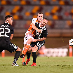 BRISBANE, AUSTRALIA - JANUARY 23: Matt McKay of the Roar passes the ball under pressure from Stephan Markus Schrock and Omid David Nazari of Ceres Negros during the AFC Champions League Second Preliminary Round match between Brisbane Roar and Ceres Negros FC on January 23, 2017 in Brisbane, Australia. (Photo by Patrick Kearney)