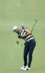 April 7, 2018 - Augusta, GA, USA - Dustin Johnson hits from the 7th fairway during the third round of the Masters Tournament on Saturday, April 7, 2018, at Augusta National Golf Club in Augusta, Ga. (Credit Image: © Jason Getz/TNS via ZUMA Wire)