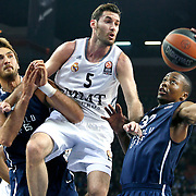Anadolu Efes's Brian Hopson (R), Semih Erden (L) and Real Madrid's Rudy Fernandez (C) during their Turkish Airlines Euroleague Basketball Game 10 match Anadolu Efes between Real Madrid at the Abdi ipekci Arena in Istanbul, Turkey, Thursday, December 19, 2013. Photo by Aykut AKICI/TURKPIX