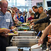 Parents and guests walk through the meal line. The evenings meals prepared by Badlands Grill for the open house that was held at Rehoboth Christian School Friday in Rehoboth.