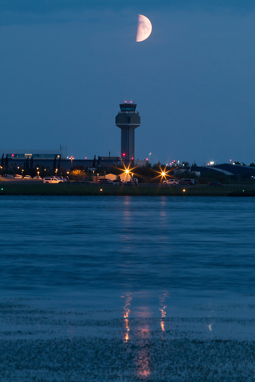 Moon setting behind the Anchorage Airport