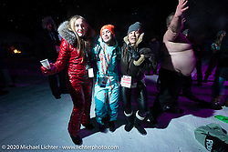 Oksana Voevodina dancing (in 6 degree F/ -14.5 C weather) with Bene Zaccherini and other friends on Lake Baikal with friends at the wrap party after the close of the Baikal Mile Ice Speed Festival. Maksimiha, Siberia, Russia. Saturday, February 29, 2020. Photography ©2020 Michael Lichter.