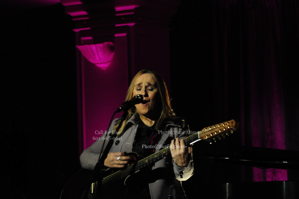 Grammy award winner Melissa Etheridge is presented with The Excellence in the Performing Arts award from the National Museum of Women in the Arts (NMWA) in Washington DC. Sunday Nov. 4, 2012. Etheridge also performed on the piano and then an acoustic set on guitar for an intimate audience of about 400 people. Photo ©Suzi Altman/For NMWA Grammy award winner Melissa Etheridge is presented with the National Museum of Women in the Arts' (NMWA) Award for Excellence in the Performing Arts in Washington DC. Sunday Nov. 4, 2012. Etheridge also performed on the piano and then an acoustic set on guitar for an intimate audience of about 300 people. Photo ©Suzi Altman/For NMWA<br /> <br /> Melissa Etheridge NMWA Award for Excellence in the Performing Arts