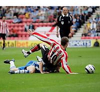 Photo: Peter Phillips.<br /> Wigan Athletic v Sunderland. The Barclays Premiership.<br /> 27/08/2005.<br /> Sunderlands Stephen Elliott is upended by Baines as he goes forward