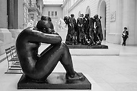 """A guard watches over """"Night"""" by Aristide Maillol (1861-1944) and """"The Burghers of Calais"""" by Auguste Rodin (1840-1917) at the Metropolitan Museum of Art."""