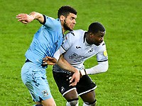 Football - 2020 / 2021 Sky Bet Championship - Swansea City vs Coventry City - Liberty Stadium<br /> <br /> Tyler Walker of Coventry City grapples with Addji Keaninkin Marc-Israel Guehi Swansea<br /> <br /> COLORSPORT/WINSTON BYNORTH