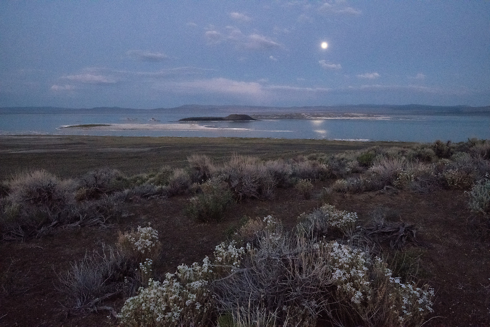The full moon stands over Mono Lake