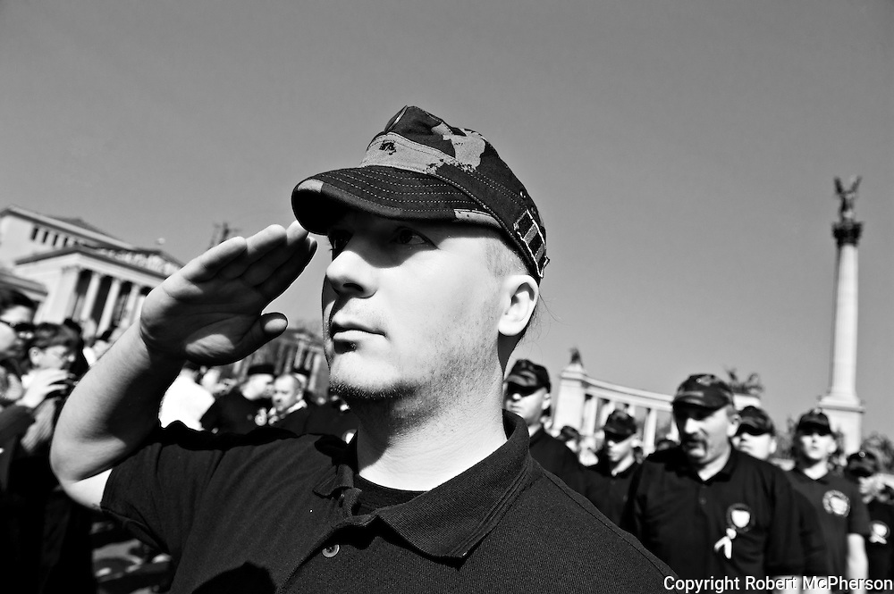 """Radical right-wing extremist group called """"The Hungarian Guard"""". By western media they are usually defined as a paramilitary organization. The Hungarian Guard have more than thousand members and is associated with the government party Jobbic. The president of """"The Hungarian Guard"""" was Gábor Vona who today is the leader of the third largest party in the government called Jobbic. Jobbic is a right-wing extremist government party."""