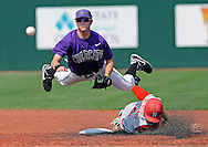 Base runner D.J. Belfonte #4 of the Nebraska Cornhuskers brakes up a double play as he takes out second basemen Jake Brown #6 of the Kansas State Wildcats in the third inning at Tointon Stadium in Manhattan, Kansas.
