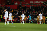 Swansea city players stand dejected as Son Heung-min of Tottenham Hotspur © celebrates with teammates after he scores his teams 2nd goal. Premier league match, Swansea city v Tottenham Hotspur  at the Liberty Stadium in Swansea, South Wales on Wednesday 5th April 2017.<br /> pic by Andrew Orchard, Andrew Orchard sports photography.
