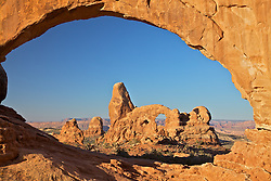 Turret Arch as seen through North Window Arch at Arches  National Park in Moab, Utah