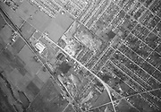 """Ackroyd 02681-06. """"Portland-Columbia airport aerials. February 13, 1951""""  looking south. Intersections of NE Cully, Killingsworth and Columbia Blvd in lower right. Scoopmobile plant on left. Columbia slough lower left."""