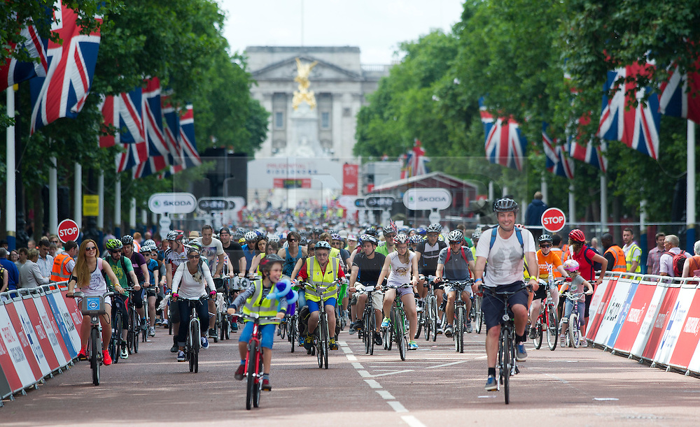 © London News Pictures. 03/08/2013. London, UK. A view along The Mall, London as cycling enthusiasts of all ages take part in the Prudential RideLondon cycling event through central London. RideLondon is an annual two-day festival of cycling, part of the legacy of the 2012 Games. Photo credit: Ben Cawthra/LNP