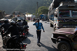 A rare policeman directs us as we pass through Hetauda before crossing the East Rapti River on day-2 of our Himalayan Heroes adventure riding from Daman to Chitwan, Nepal. Wednesday, November 7, 2018. Photography ©2018 Michael Lichter.