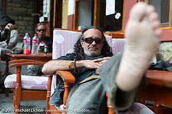 Cool Beans Chris Marino having a rest after lunch in the village of Tatopani on Motorcycle Sherpa's Ride to the Heavens motorcycle adventure in the Himalayas of Nepal. On the third day of riding, we went from Pokhara to Kalopani. Wednesday, November 6, 2019. Photography ©2019 Michael Lichter.