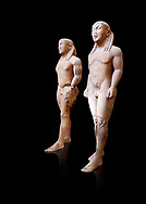 Archaic Ancient Greek marble statue of 2 Kouros Known as the Twins of Argos sculpted in Argos circa 580 BC, Delphi National Archaeological Museum.   Against black
