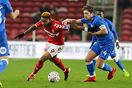 Middlesbrough forward Britt Assombalonga (9) and Peterborough United midfielder Alex Woodyard (4) battle for the ball during The FA Cup 3rd round match between Middlesbrough and Peterborough United at the Riverside Stadium, Middlesbrough, England on 5 January 2019.